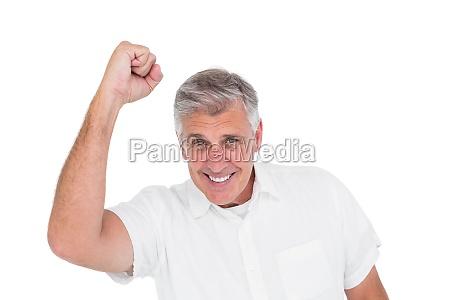 casual man cheering at camera