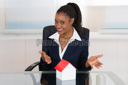 businesswoman presenting a house model
