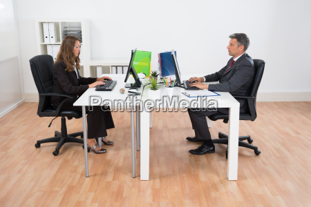 two businesspeople in office