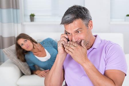 woman looking at man talking on