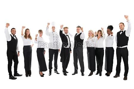 portrait of happy restaurant staff celebrating