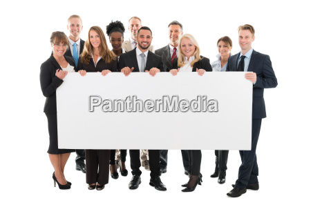 confident multi ethnic business team holding