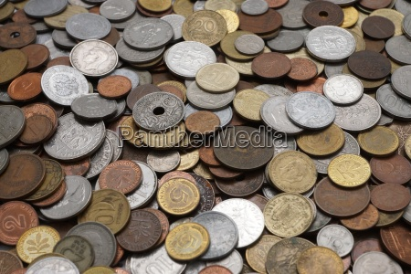 various currencies old lying on a