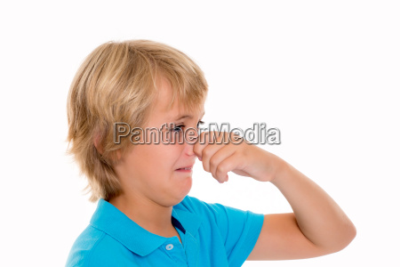 blond boy holding his nose