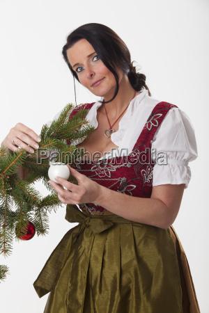 bavarian woman with a christmas tree