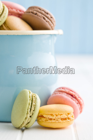 sweet french macarons on kitchen table