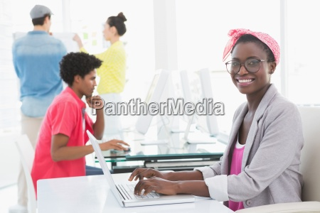 young creative woman using laptop at