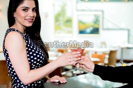 pretty woman receiving her drink in