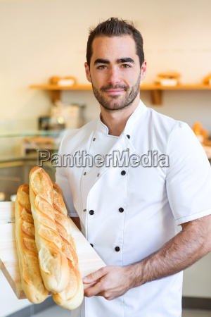 young attarctive baker working at the