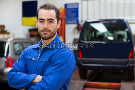 young, attractive, mechanic, working, at, the - 15440421