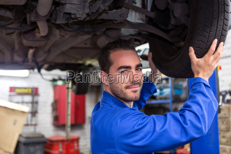 young, attractive, mechanic, working, on, a - 15440617