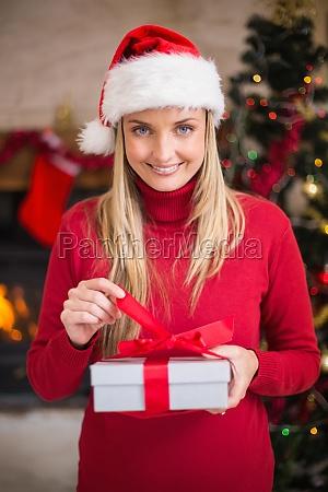 smiling woman in santa hat opening