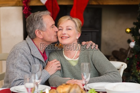 mature man kissing the cheek of