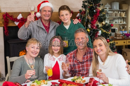 family toasting with white wine in