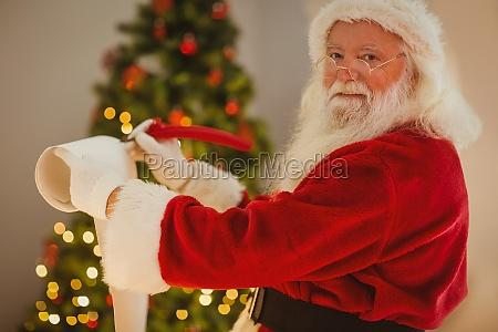 smiling santa claus writing list