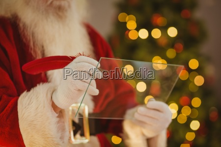santa claus writing list on the