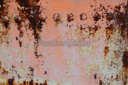 rusty iron plate with rivets