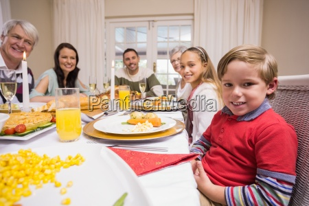 three generation family having christmas dinner