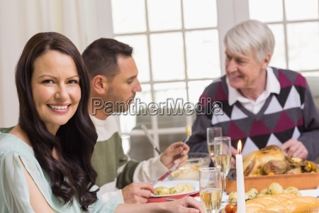 smiling woman during christmas dinner