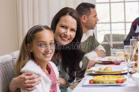 girl and mother at christmas dinner