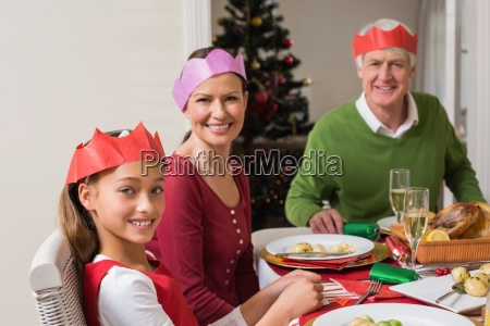 smiling extended family in party hat
