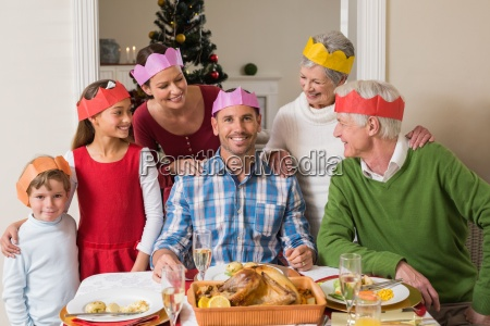 cheerful extended family in party hat