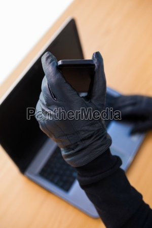 hands with leather gloves using laptop