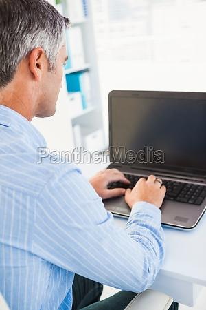 focused man using his laptop