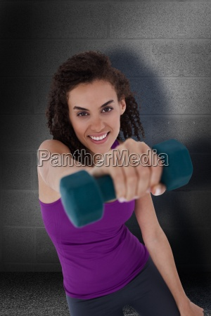 composite image of fit woman lifting