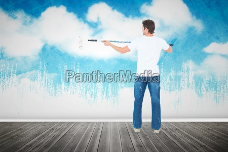 composite image of man using paint