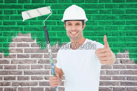 composite image of man holding paint