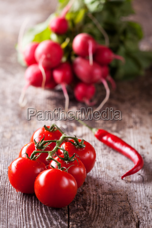 tomatochilli and red radisches on a