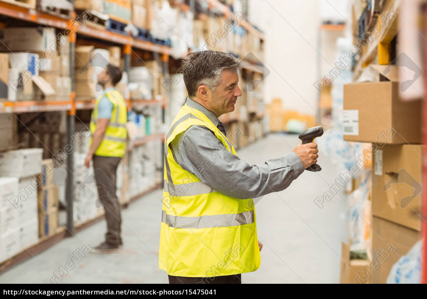Royalty free image 15475041 - Warehouse worker scanning barcode on box