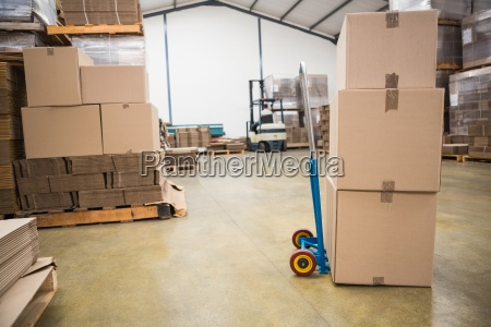 boxes on trolley in warehouse