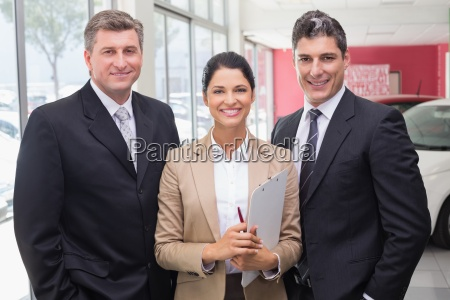 smiling business team standing in a