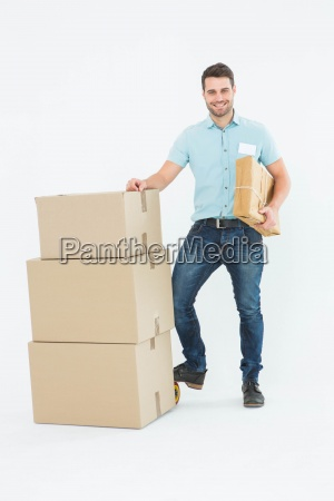 courier man with cardboard boxes