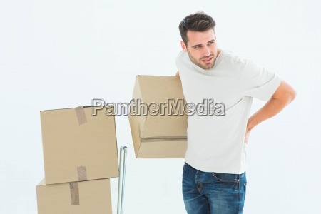 delivery man with cardboard boxes suffering