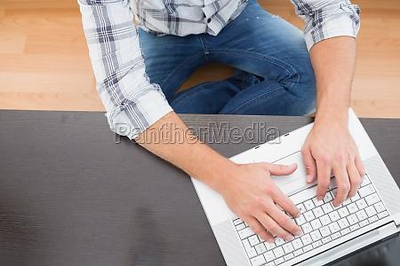 a man sitting on the floor