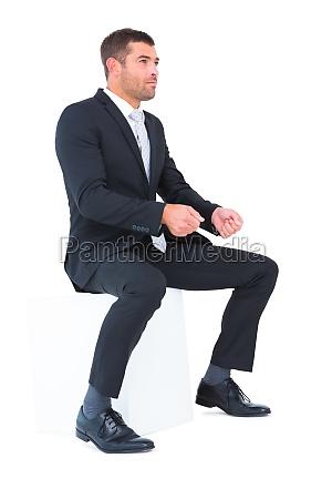 businessman sitting put his hands front