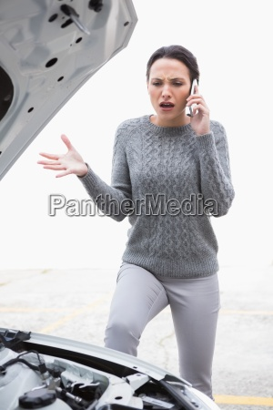 angry woman calling for assistance after