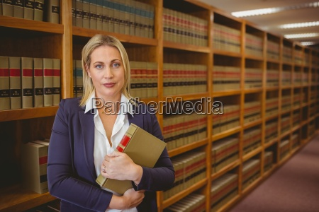 female librarian posing and holding a
