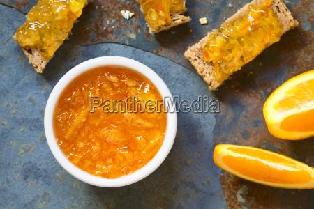 orange jam in bowl