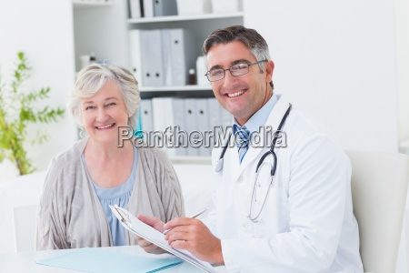 happy doctor and female patient in