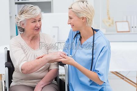 female nurse checking flexibility of patients