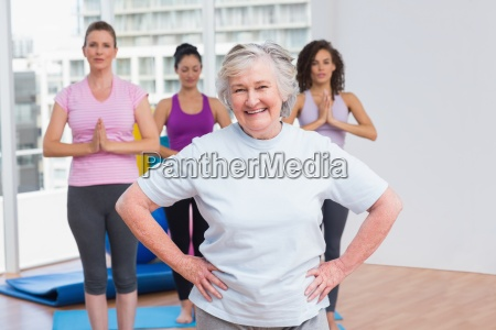 senior woman with hands on hip