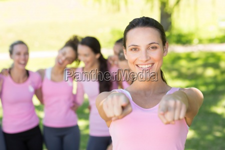 smiling women in pink for breast
