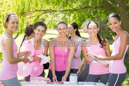 smiling women organising event for breast