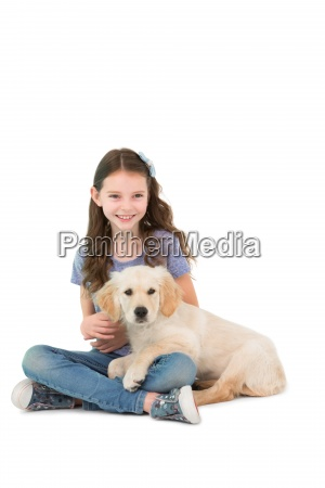 happy little girl sitting with dog
