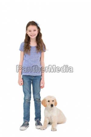 smiling little girl standing next to