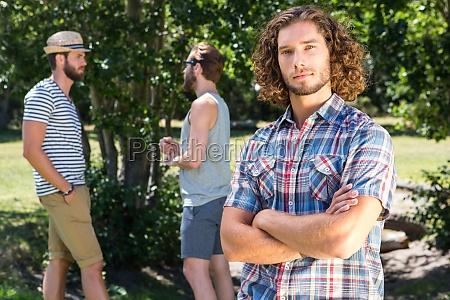 young man frowning at camera in